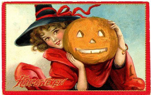 Обои Девочка в шляпе ведьмы и красной накидке держит в руках тыкву-светильник (Halloween / Хэллоуин)