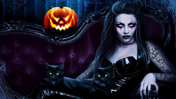 Обои Вампирша с двумя кошками лежит на диване