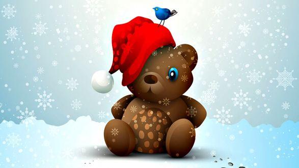 Обои Рисунок плюшевого медвежонка с новогоднем колпачке, на мишке сидит маленькая синяя птичка, на земле лежит снег и кружат большие снежинки