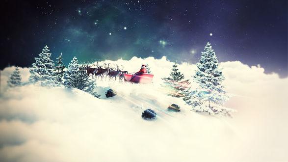 Обои Дед Мороз мчится на санях запряженными оленями по заснеженному лесу