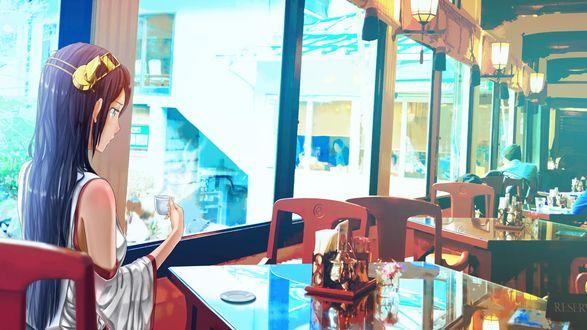 Обои Девушка сидя в кафе пьет чай