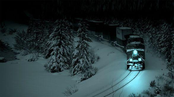 Обои Поезд выезжает из заснеженного леса