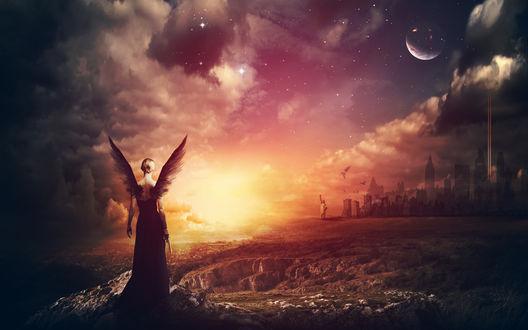 Обои Девушка-ангел с пистолетом в руке стоит на скале и смотрит на город виднеющийся вдали