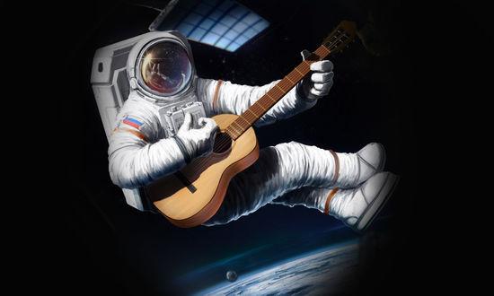 Обои Космонавт с гитарой