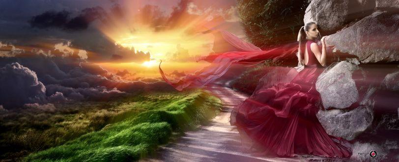 Обои Девушка в красном платье стоит лицом к скале, слева от нее дорога, трава, облака и все освещено яркими лучами солнца, фотограф Арам Мнацаканов, модель Мария Похилько