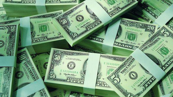 Обои Пачки денег в долларах