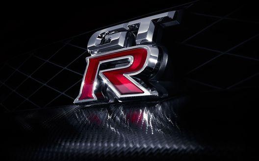 Обои Логотип торговой марки Nissan GT-R — суперкара, выпускаемый компанией Nissan Motor