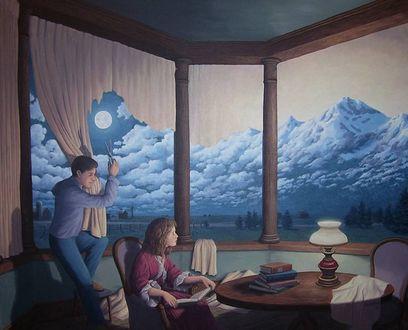 Обои Парень с девушкой сидят в комнате, за окном которой облака над горами