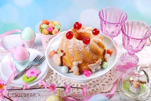 Обои Кулич и крашенные яйца на красиво сервированном в розовых тонах столике к пасхе