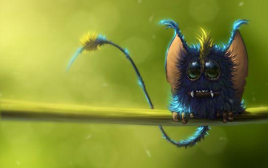 Обои Пушистый синий монстрик с желтым хохолком, клыками, большими зелеными глазами, оттопыренными розовыми ушами и длинным тонким хвостом сидит на зеленой ветке