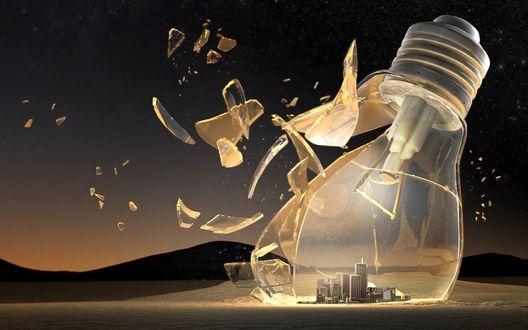 Обои Разбивающаяся электрическая лампочка, внутри которой расположен город. На фоне мрачного фантастического пейзажа