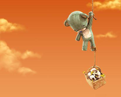 Обои Плюшевый медведь висит на веревке, к его ноге привязана корзина с цветами и черепами