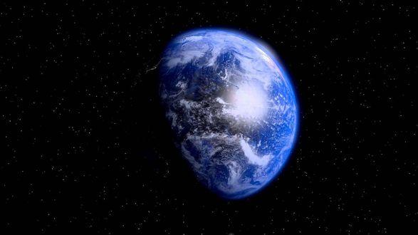 Обои Голубая планета на черном фоне среди звезд