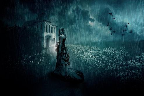 Обои Девушка в длинном платье с фонарем в руке стоит под дождем недалеко от дома, by bcamelier