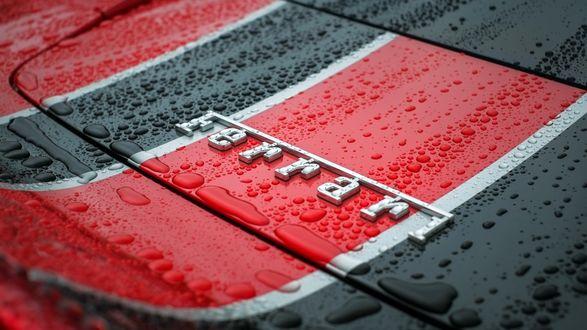 Обои Логотип знаменитой фирмы Ferrari в каплях воды