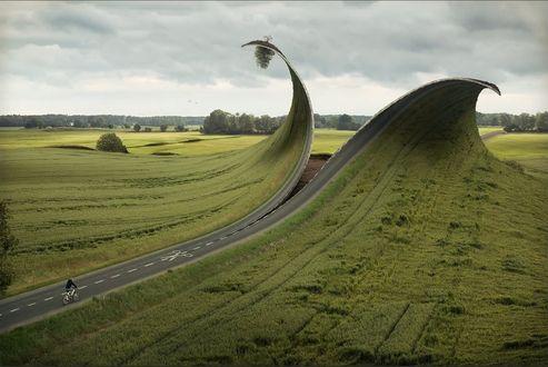 Обои Ножницы разрезают шоссе по пунктиру разделительной линии; окружающий пейзаж и края дороги, по которой едет велосипедист, загибаются как простая бумага, by Eric Johansson / Эрик Йоханссон