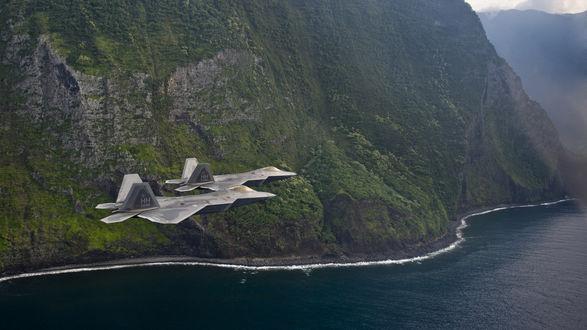 Обои Военные истребители облетающие горы у океана