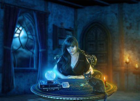 Обои Гадалка за рабочим столом на котором сидит черный котенок, книги, карты для гадания, хрустальный шар, горят свечи