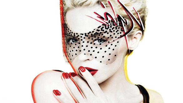 Обои Австралийская певица Кайли Миноуг / Kylie Minogue в черной гламурной маске на лице