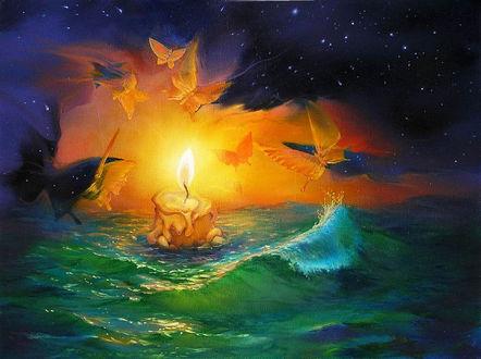 Обои Свеча стоит по среди моря, на ее свет слетаются мотыльки