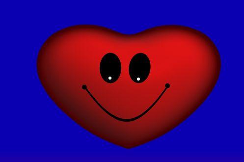 Обои Улыбающееся сердечко на синем фоне