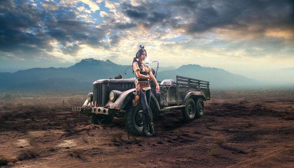 Обои Девушка одетая в стиле стимпанк возле машины на фоне пустыни