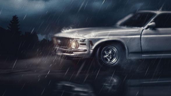 Обои Автомобиль едущий под дождем