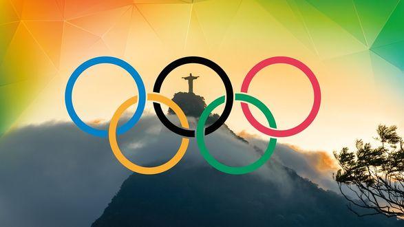 Обои Олимпийские кольца на фоне Статуи Христа Искупителя в Рио Де Жанейро (Бразилия)