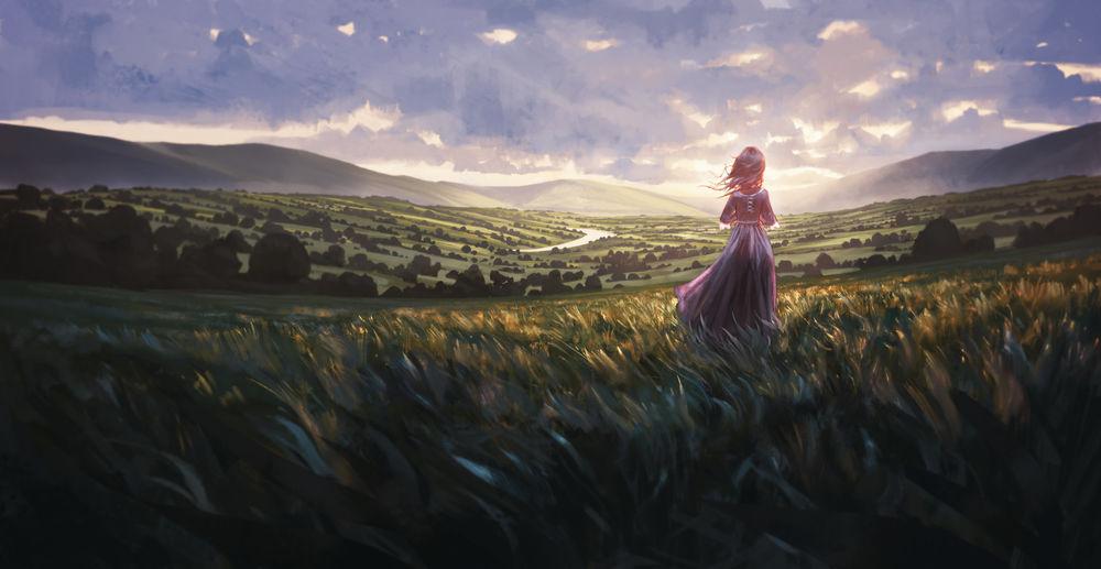 Обои для рабочего стола Девушка стоит в поле на фоне облачного неба
