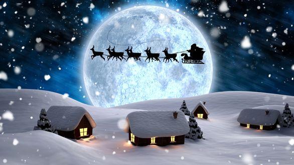 Обои Ночью над домами в небе пролетел Санта Клаус на санках с оленями
