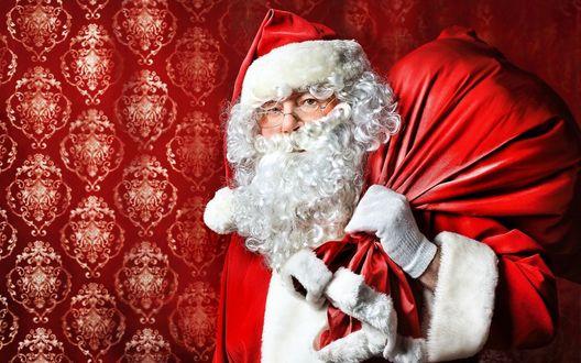 Обои Обои. Дед Мороз с огромным, красным мешком с подарками.(Дед Мороз несет игрушки, И гирлянды и хлопушки. Хороши подарки, Будет праздник ярким!)