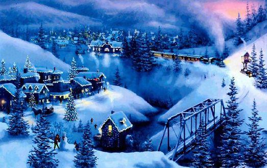 Обои Поезд едет по деревне в горах в Рождество
