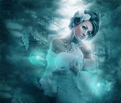 Обои Девушка держит в руках зайца на фоне веток и лунного света, снежинок