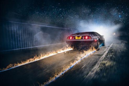 Обои Легковое авто с пылающим и дымящимся следом, эпизод фильма Назад в будущее
