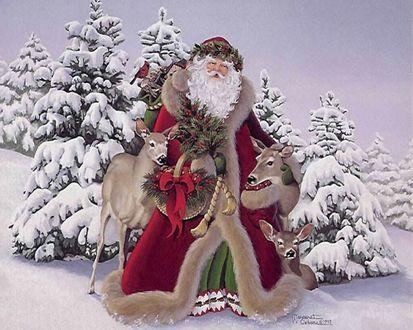 Обои Дед Мороз с веткой елки в руке, рядом оленята на фоне зимних елок, покрытых снегом