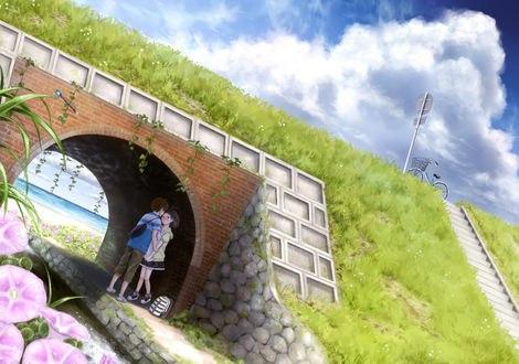 Обои Мальчик с девочкой целуются под мостом