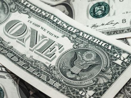 Обои Долларовые купюры крупным планом, сверху лежит один доллар / One dollar (United States of America, In God we trust)