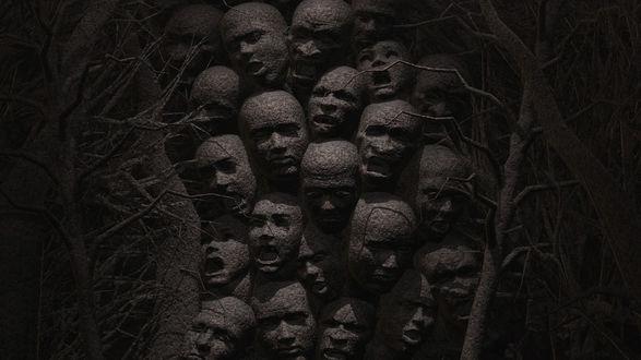 Обои Страшные лица вырастают из коричневого дерева