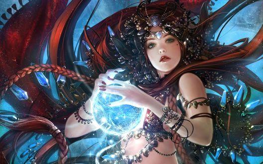 Обои Длинноволосая девушка в украшениях держит в руках магический шар