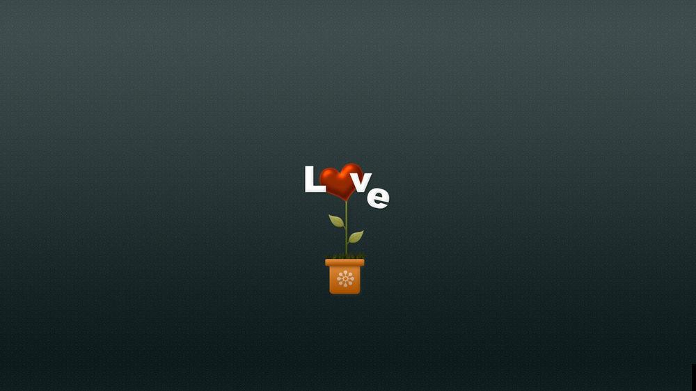 Обои для рабочего стола Цветок сердце с надписью love / любовь по среди серого фона