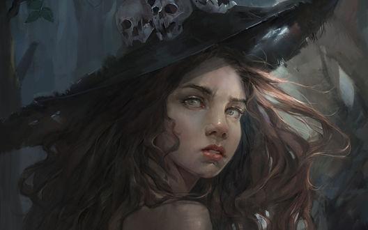 Обои Девушка-ведьма в шляпе с черепами