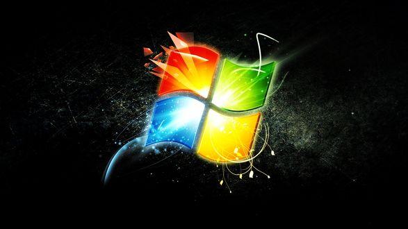 Обои На черном фоне яркий и красочный логотип windows