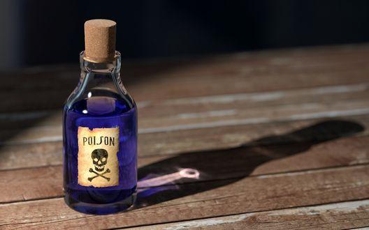 Обои Пузырек с синей жидкостью и надписью (poison / яд) стоит на столе
