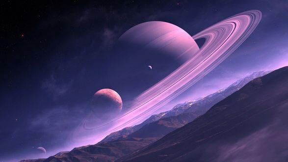 Обои Планета Сатурн со спутниками в небе над горами