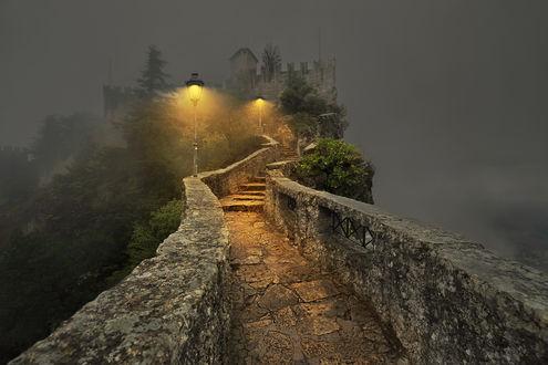 Обои Дорога, освещенная фонарями, ведет к замку на вершине скалы, by GaL-Lina