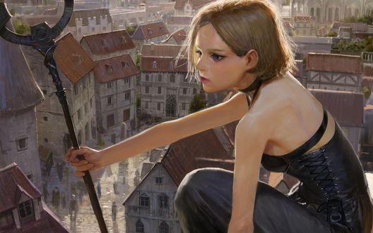 Обои Девушка с посохом в руке на фоне города