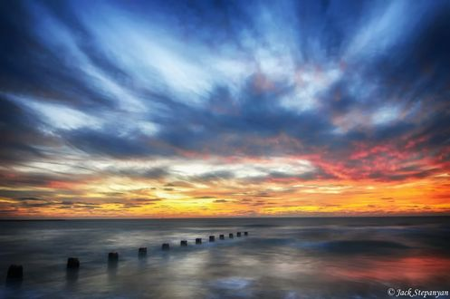 Обои Побережье на фоне разноцветного неба с облаками, by Jack Stepanyan