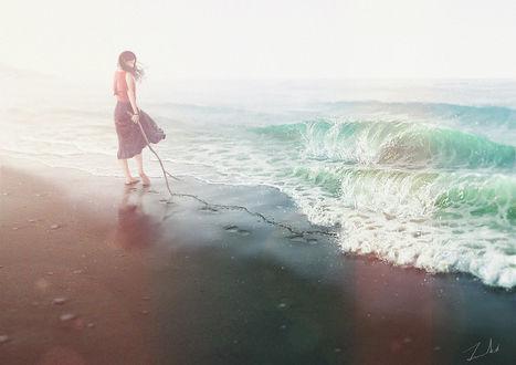 Обои Девушка стоит с палкой в руке у моря