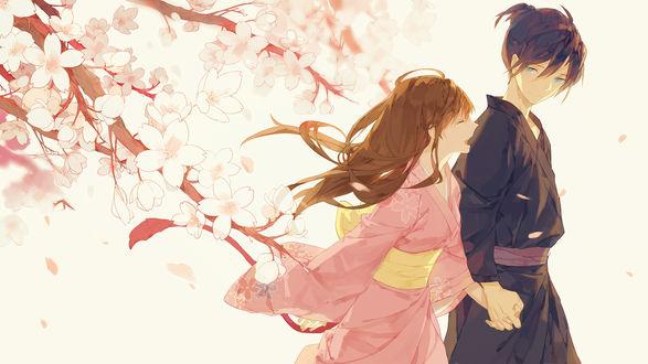 Обои Ято / Yato и Ики Хиери / Hiyori Iki из аниме и манги Бездомный бог / Noragami, держась за руки стоят возле цветущих веток сакуры