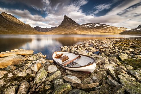 Обои Лодка на каменнистом берегу, фотограф Janne Kahila